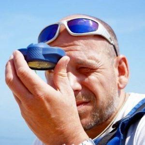 taking a bearing while navigating on a sailboat
